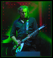 Portrait of Peter Buck (click to view image source)